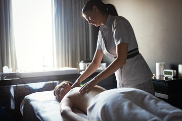 Young and healthy woman in spa salon. Traditional Swedish massage therapy