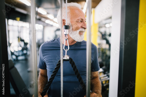 Senior man at the gym doing exercise to stay healthy © nd3000