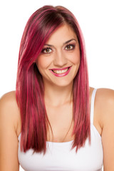young smiling woman with pink hair on white background