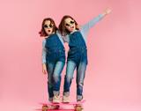Stylish cute girls with skateboard - 247753264