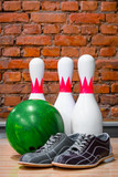 bowling pins, ball and shoes
