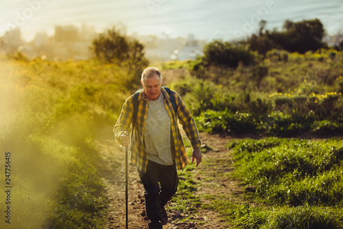Senior man pursuing his adventure dreams - 247756415
