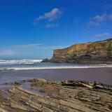 rocks on the ocean, seascape, beautiful sandy beach, clear blue sky, sunny weather