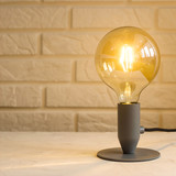 Yellow minimalist modern lamp in the interior on the background of a brick wall on the desktop. Background, copy space - 247798664