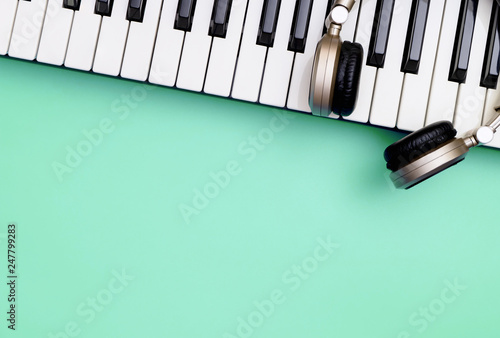 Music keyboard synthesizer instrument with headphone on blue copy space for Music poster concept - 247799283
