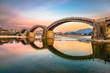 Leinwanddruck Bild - Iwakuni, Japan at Kintaikyo Bridge over the Nishiki River at dusk.
