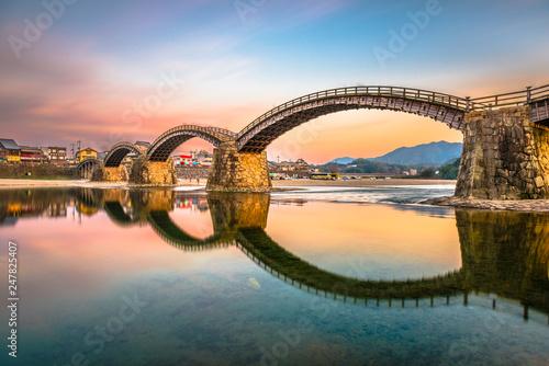 Leinwanddruck Bild Iwakuni, Japan at Kintaikyo Bridge over the Nishiki River at dusk.