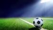 Leinwanddruck Bild - Tradition soccer ball illumintaed by stadium lights