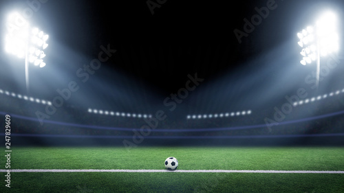 Tradition soccer ball illumintaed by stadium lights © Mariusz Blach