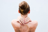 Young woman having pain in the back and neck. Health-care Concept. - 247830495