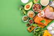 Mediterranean diet concept - meat, fish, fruits and vegetables on bright green background - 247848452