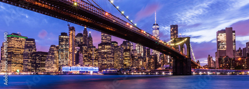 Brooklyn Bridge with skyscrapers background. New York City, USA. Brooklyn Bridge is linking Lower Manhattan to Brooklyn.. - 247855690