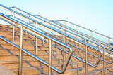 Stainless steel railings on the steps - 247857276