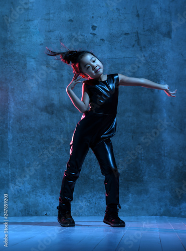 High Fashion asian model girl in colorful bright neon uv blue and purple lights colorful make up - 247859203