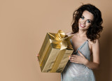 Sensual woman with gold present gift box for birthday party smiling  - 247860259