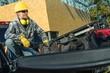 Leinwandbild Motiv Worker Seats on a Truck