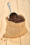 isolated fabric sack with coffee beans