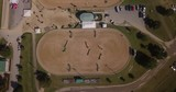 Top down view of the warm up ring at an equestrian show jumping competition - 247884449
