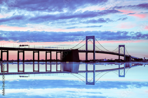fototapeta na ścianę Span of the Throgs Neck Bridge in New York City colorful sky at dusk