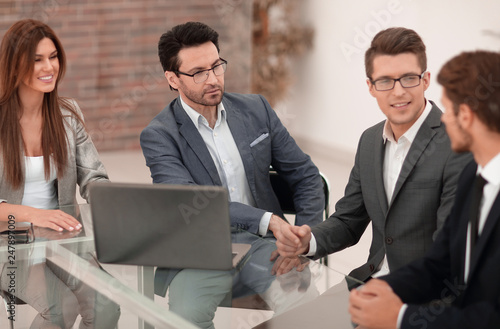 business team holds a business meeting - 247897009