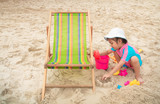 Little asian girl playing on the beach at Pattaya,thailand. Vacation and relax concept. - 247899245