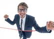 Leinwandbild Motiv Cheerful businessman crossing red finish line