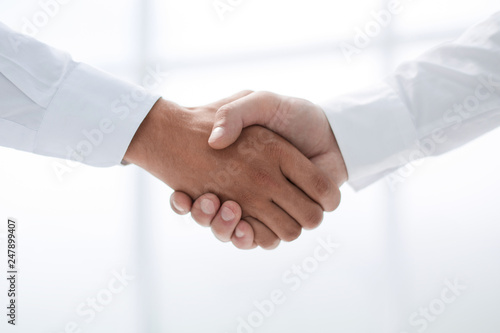 Leinwanddruck Bild close up.handshake of business people on a light background