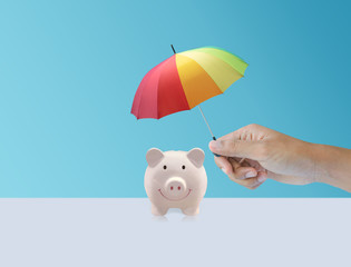 pink piggy ceramic bank with colorful rainbow umbrella, safe insurance