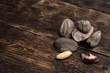 Quadro Brazil nuts on a brown wooden board background.
