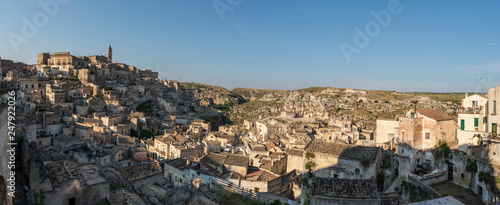 Sassi of Matera. Sasso Barisano at sunset. Magic of cave houses. UNESCO World Heritage Site. - 247922026