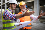 Team of architects and engineer in group on construciton site check documents and business workflow - 247937479