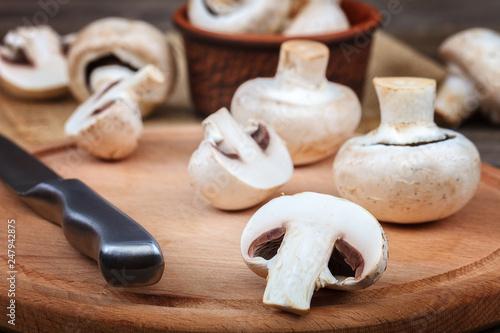 Leinwandbild Motiv Fresh fruits of mushrooms on a wooden board