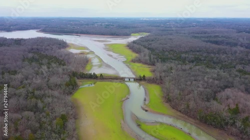 Aerial footage of a small bridge over a creek.