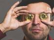 Leinwandbild Motiv Man having bitcoin in eye