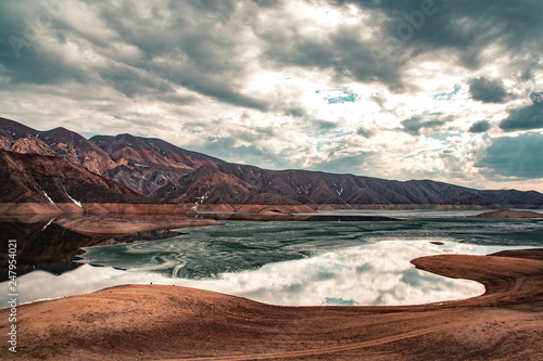 lake with mountain under sky