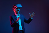 Shouting businessman in vr goggles - 247957846