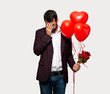 Man in valentine day with tired and sick expression over isolated grey background