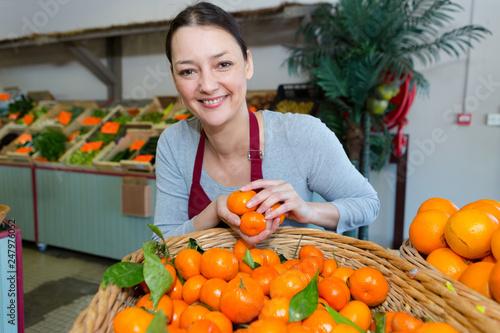 orange female vendor posing