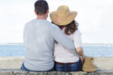 back view of couple hugging near the sea - 247978227