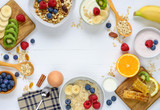 Healthy breakfast concept on white wooden table.