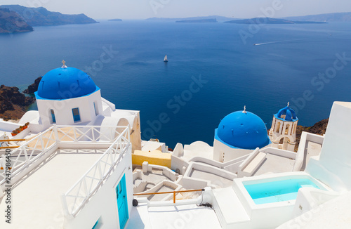 Sunny morning view of Santorini island. Famous Greek resort Oia, Greece, Europe. Traveling concept background.