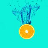 Fresh Orange with a water splash on background.