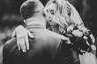 Leinwandbild Motiv Beautiful romantic wedding couple of newlyweds hugging in park