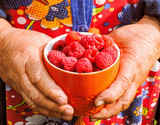 Fresh Raspberries background. Strawberry. Food background.Copy space. Top view, healthy food for breakfast. Eco, organic summer diet food. Ripe Raspberries from garden in a mug .Summer Raspberries .