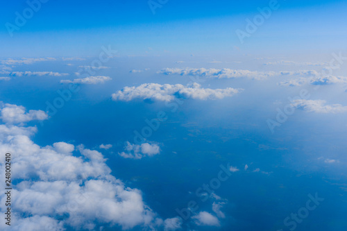 clouds from airplane window - 248002410
