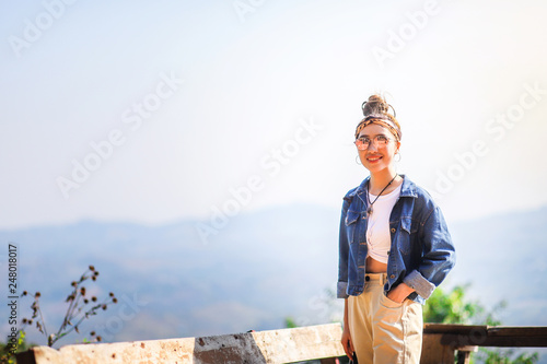 Beautiful Asian woman standing at the view point