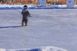 Young Hockey Player Chasing a Puck