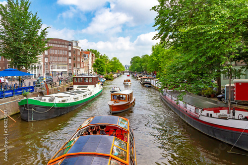 Idyllic Amsterdam with cannel and boats