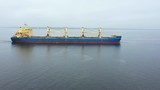 Cargo barge goes on a calm sea. Aerial view - 248034613