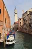 Canal and church tower in Venice, Italy